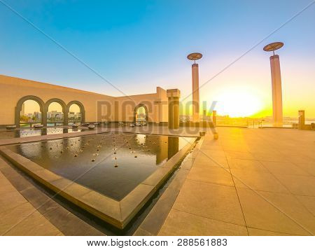 Doha, Qatar - February 20, 2019: Courtyard Of Museum Of Islamic Art With Fountains, Benches And Arch