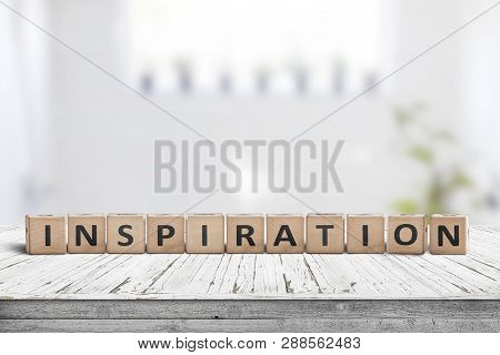 Inspiration Sign On A Wooden Table In A Bright Room With Green Plants