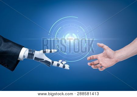 Robots Hand In Suit And Mans Hand Reaching Out For Handshake With Spherical Hologram Object In The B