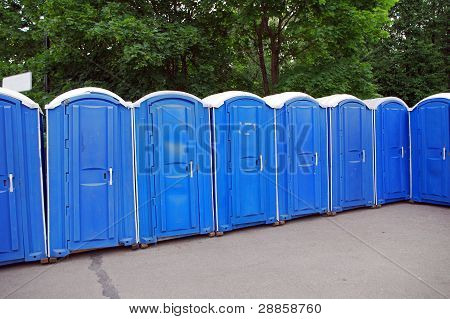 Row Of Blue Public Toilets In Moscow Park