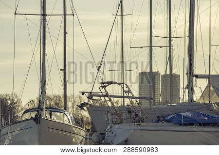 Yacht Masts And Various Yachts On City Center On The Background