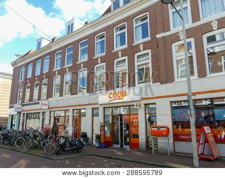 The Hague, The Netherlands - March 7 2019: Historical Red Brick Apartment Building In The Hague With