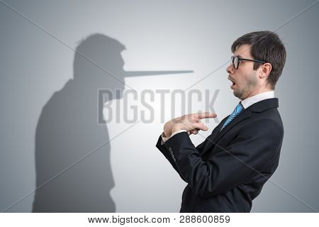 Liar Has Shadow With Long Nose. Conscience Concept.