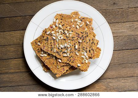 Dehydrated Raw Vegan Bread On White Plate
