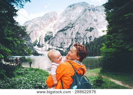 Family Of Tourists On Walks On Braies Lake. Woman And Baby Girl On Lake Shore Of Lago Di Braies In D