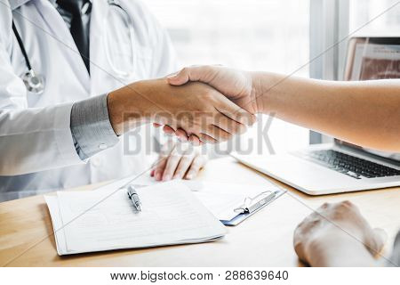 Confident Doctor Shaking Hands With Patients Talk In The Hospital
