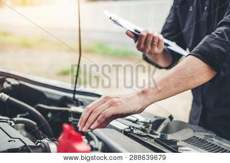 Auto Mechanic Working In Garage Technician Holding Clipboard And Check Mechanic Maintenance Car Chec