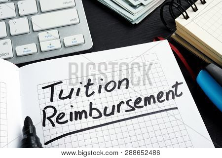 Tuition Reimbursement Written On A Page Of Notepad.