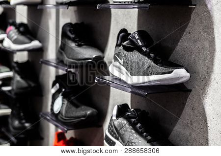 Nurmberg, Germany - February 27, 2019: The Nike Black Man Sneakers On The Shell In The Shop. Fashion