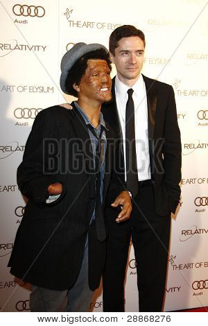 LOS ANGELES, CA - JAN 14: Topher Grace; Jacques Kaplan-Abrahams at the 2012 Art of Elysium Heaven Gala at Union Station on January 14, 2012 in Los Angeles, California