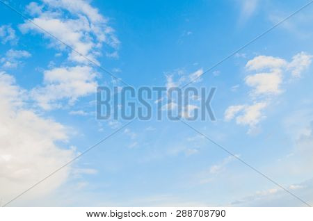 Sky background. Blue sky landscape with dramatic sunset clouds lit by evening sunset light. Sky landscape of blue vast colorful sky clouds. Sunset sky landscape scene with dramatic sky clouds