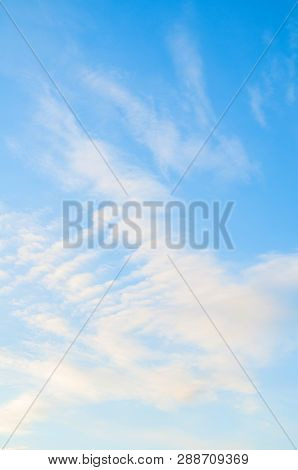 Sky background. Blue sky landscape with colorful sunset clouds lit by evening sunset light - evening sky view. Sky landscape of blue vast colorful sky clouds. Sunset sky landscape scene with dramatic sky clouds