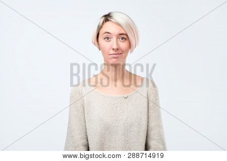 Doubt, Mistrust, Distrust Concept. Doubtful Woman Looking With Disbelief Expression At Studio.