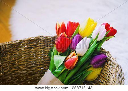 Tulips Flowers In Wicker Straw Basket.