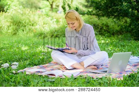 Woman With Laptop Sit On Rug Grass Meadow. Girl With Notepad Write Note. Freelance Career Concept. G