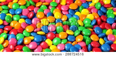 Candies Colorful Background With Multicolored Chocolate Coated Candy Top View Close Up.