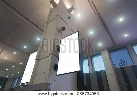 Flight Status Dual Monitor Screens In A Modern Airport