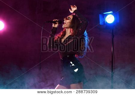 Beautiful Singing Girl Curly Afro Hair. Beauty Woman Singer Sing With Microphone Karaoke Song On Sta