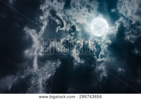 Landscape Of Sky With Dark Clouds At Nighttime. Beautiful Full Moon Behind Cloudy With Moonlight, Se
