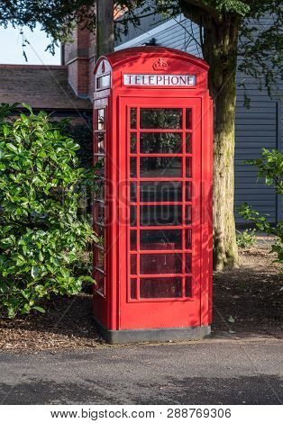 Chester, Uk - 21 February 2019: British Telecom Bright Red Phonebox Among Bushes In England