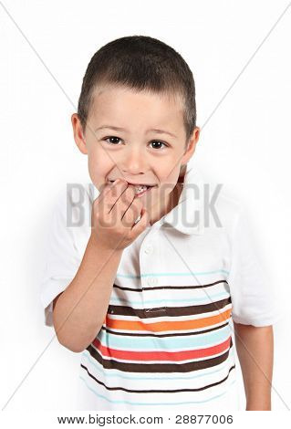 Little boy posing with arms crossed on white
