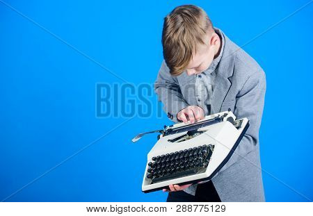 Using A Typing Machine. Small Kid Typewriting On Old Typewriter. Smart Schoolboy With Vintage Typewr