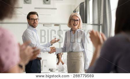 Happy Manager Boss Praising Old Employee Get Team Appreciation