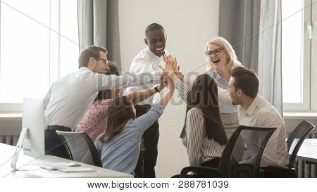 Happy Diverse Employees Business Team Engaged In Teambuilding Giving High-five