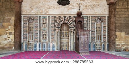 Cairo, Egypt - December 2 2018: Colorful Decorated Marble Wall With Engraved Mihrab (niche) And Wood