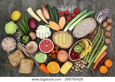 High fibre super food with grains, fruit, vegetables, whole grain bread rolls, seeds, nuts and cereals. Health foods high in antioxidants, omega 3, anthocyamnins, and vitamins.