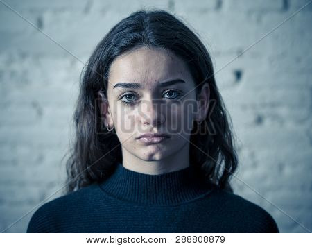 Portrait Of Young Sad Frightened Girl Suffering From Bullying, Child Abuse Or Domestic Violence.