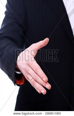 Businessman giving his hand to you for handshake