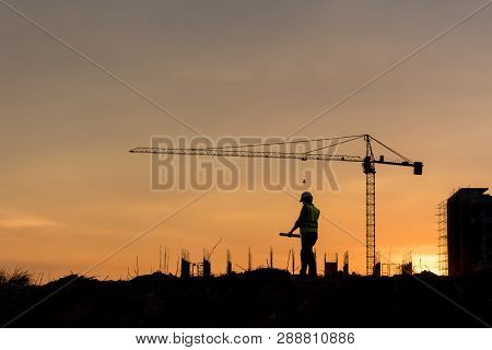 Silhouette Engineer Construction Work Control And Tower Crane Background On Natural Sunset Sky.,heav