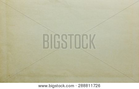 Old Weahtered Grunge Paper Texture Background Of Dirty Seamless Canvas. Retro Style Rustic Cardboard
