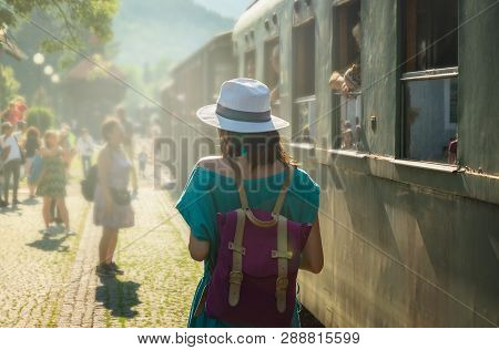 Traveler Girl On Train Station In Vacation. Young Traveler Girl In Vacation. Girl Traveling By Train