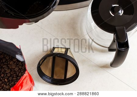 Basket Coffee Filter, Drip-type Coffee Maker And Coffee Beans On The Kitchen Table, Top View. Reusab