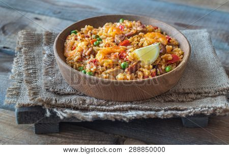 Bowl Of Chicken And Chorizo Paella With Lemon Wedge