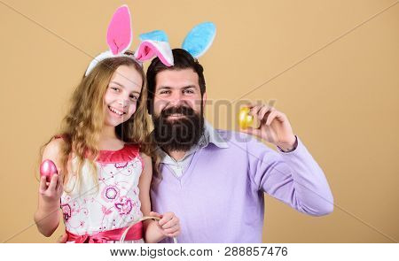 Hope And Rebirth. Happy Father And Child With Colored Easter Eggs. Happy Family. Family Celebrating