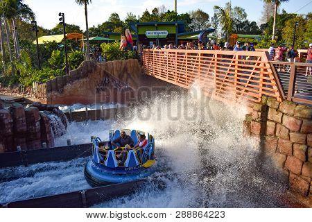 Orlando, Florida. March 09, 2019 People Having Fun Kraken Rollercoaster At Seaworld Marine Theme Par