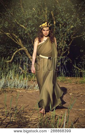 Woman In The Toga Is On The Beach