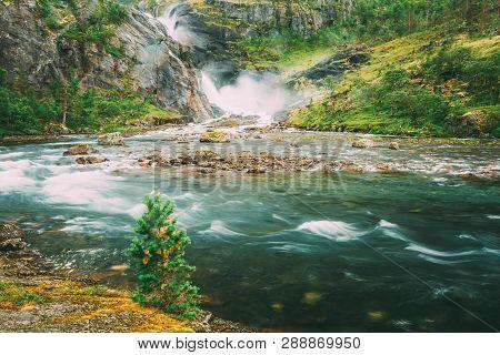Beautiful Waterfall In The Valley Of Waterfalls In Norway. Husedalen Waterfalls Were A Series Of Fou