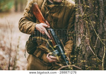 Unidentified Re-enactor Dressed As Russian Soviet Soldier In Camouflage In Forest