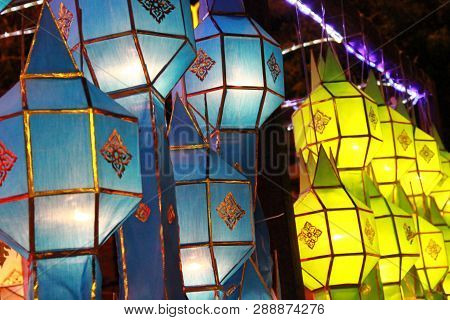 Blue And Yellow Lanna Lantern Lamp In Loy Kratong Festival, Or Call Yee Peng Festival At Northern Of