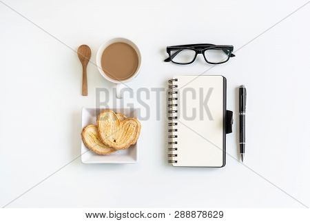 Cup Of Coffee With Snacks And Notebook On Desk Office With Copy Space, Top View