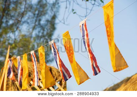 The Flag Of The Buddhist Flags And Kingdom Of Thailand Flags On Blue Sky Background In The Evening W