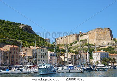 Bonifacio Port, Corsica Island - June 13, 2015: Sailing Yacht Boats Anchoring In Bonifacio Port With