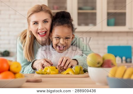 Foster Mother Feeling Happy Cooking Together With Her Girl