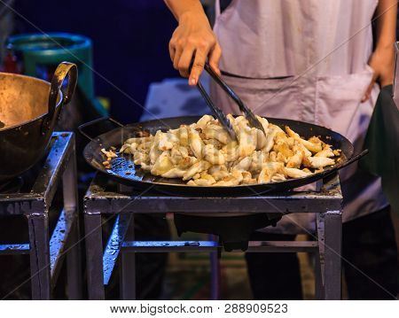 Traditional Asian Thai Street Food And Fast Food, Delicious Hot Pan Fried Nidamental Glands Of Cuttl