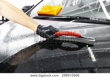 A Man Cleaning Car With Plastic Sponge. Car Detailing Or Valeting Concept. Selective Focus. Car Deta