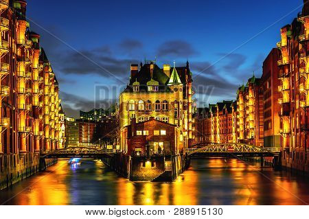 The Warehouse District Speicherstadt During Twilight Sunset In Hamburg, Germany. Illuminated Warehou